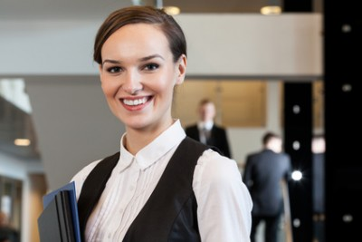 Beautiful woman standing in business centre